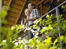 Couple On Terrace With Binoculars Stock Photography