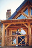 Couple on terrace of house. Couple on terrace of mountain house Stock Photography