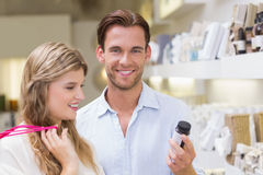 A couple testing a sample of beauty products Royalty Free Stock Photo