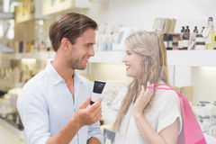 A couple testing a sample of beauty products Stock Images