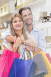 A couple testing a sample of beauty products Royalty Free Stock Photography