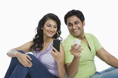 Couple text messaging on mobile phones Stock Image