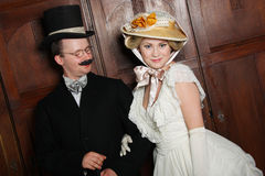 Couple in 19th century garment with woman in dominant role royalty free stock images