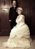 Couple in 19th century garment with woman in dominant role royalty free stock image