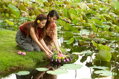 Couple Thai pretty woman in floating flower joist. Couple Thai pretty women in Thai style clothes floating flower joist Stock Images
