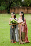 Couple thai woman  traditional dress. Royalty Free Stock Image