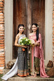 Couple thai woman  traditional dress. Royalty Free Stock Images