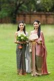 Couple thai woman  traditional dress. Stock Photos