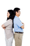 Couple with their backs to each other. And arms folded royalty free stock photos