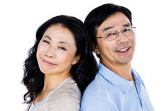Couple with their backs to each other. And smiling royalty free stock image