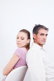 Couple with their Backs Turned. Towards eachother Royalty Free Stock Photo