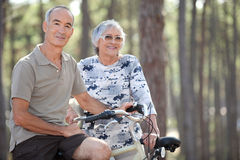 Couple on their bicycles Royalty Free Stock Images