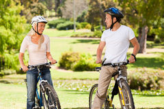 Couple with their bikes outside Stock Photography