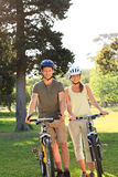 Couple with their bikes in the park Royalty Free Stock Image