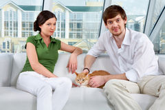 Couple and their cat Stock Image