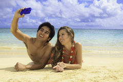 Couple with their cell phone royalty free stock image