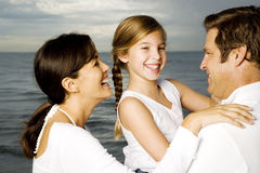A couple with their daughter on a beach Royalty Free Stock Image