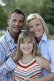 Couple with their daughter. Stock Photos