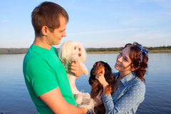 Couple with their dogs Royalty Free Stock Photography
