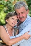 Couple in their fifties. A happy couple in their fifties hugging each other Royalty Free Stock Images