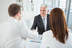 Couple With Their Financial Advisor Stock Photography
