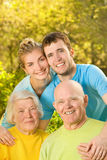 Couple and their grandparents. Young couple and their grandparents outdoors Royalty Free Stock Photo
