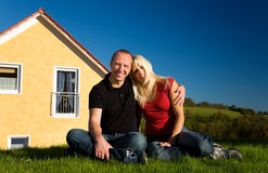 Couple and their home Stock Photography