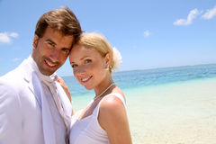 Couple on their honeymoon. Portrait of just married couple on the beach Stock Photo