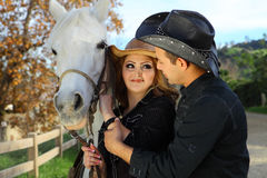 Couple with their horse Royalty Free Stock Image