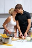 Couple in their kitchen making dinner Stock Photo