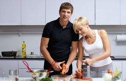 Couple in their kitchen making dinner Stock Image