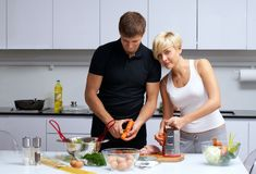 Couple in their kitchen making dinner Royalty Free Stock Photo