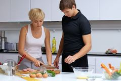 Couple in their kitchen making dinner Royalty Free Stock Photography