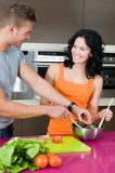Couple in their kitchen with salad Royalty Free Stock Photo