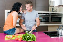 Couple in their kitchen with salad Royalty Free Stock Photos