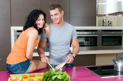 Couple in their kitchen with salad Stock Image