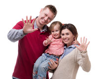 Couple and their little daughter with palms up. Isolated on white background Stock Photos