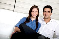 Couple in their living room Royalty Free Stock Photos