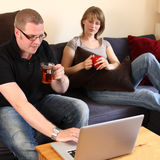 A Couple in Their Living Room Stock Photography