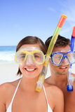 Couple with their mask at the beach Royalty Free Stock Photo