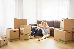 Couple in their new apartment sitting on floor Royalty Free Stock Image