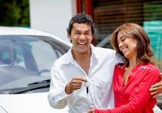 Couple with their new car Stock Photo