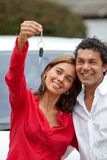 Couple with their new car Royalty Free Stock Image