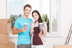 Couple at their new empty apartment Royalty Free Stock Photos