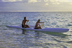 Couple in their outrigger. Couple in their forties with their outrigger canoe in hawaii stock photography