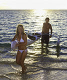 Couple with their outrigger. Couple in their forties with their outrigger canoe in hawaii Stock Image