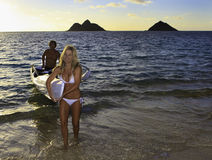 Couple with their outrigger. Couple in their forties with their outrigger canoe in hawaii Stock Photography