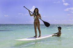couple with their paddle board Stock Photo