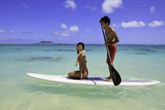 Couple with their paddle board royalty free stock images