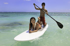 Couple with their paddle board Stock Images